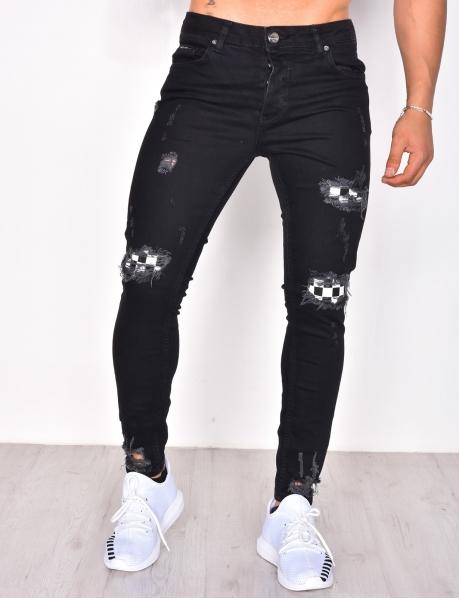 Jeans destroy à doublure carreaux