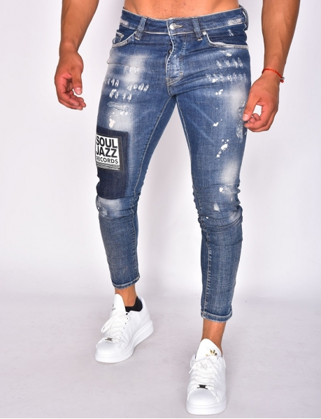 Jeans destroy à écusson