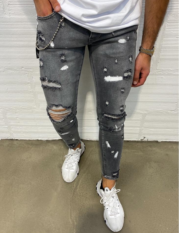 Jeans destroy à tâches et chaine