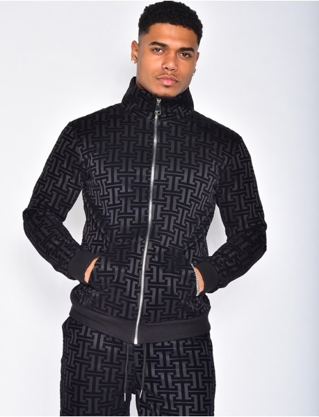 Geometrically patterned bi-material jacket